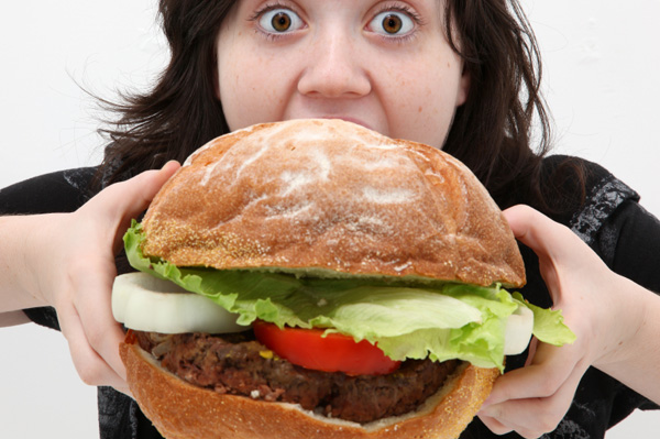 http://nycityeats.com/wordpress/wp-content/uploads/2011/04/woman-eating-giant-burger.jpg