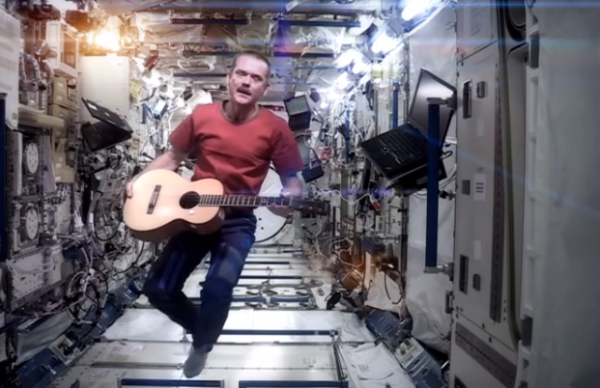 Chris Recording his Video song i the spacecraft flying in weightlessness