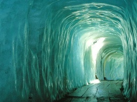 Ice Tunnel In Rhone Glacier (Switzerland)