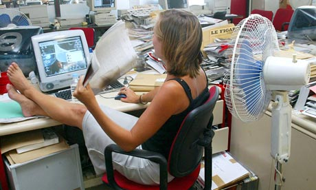 An office worker fanning herself
