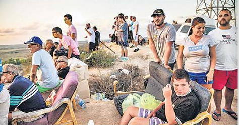 Israelis Atop Sderote Watching Gaza Bombing