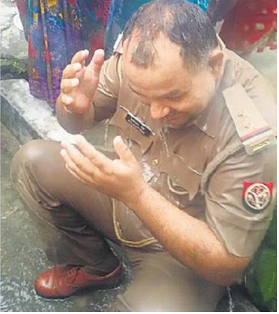 You See Here How To Please The God By Bathing the Police Chief